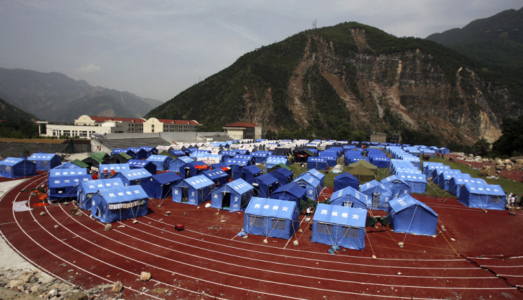 Image: Temporary relief tents located inside a sports stadium in earthquake-hit Beichuan