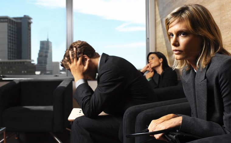Two Women and a Man Waiting in an Office