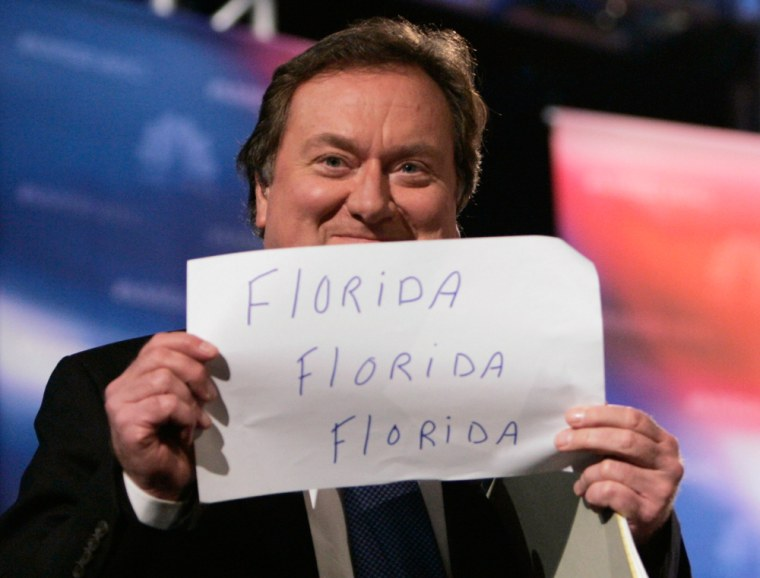 File photo of NBC talk show host Russert holding sign as he takes the stage at Florida Atlantic University in Boca Raton