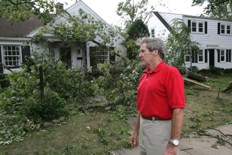 Image: James Mullaney looks at the damaged houses on St. Ives Court area of Louisville, Ky