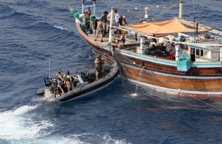 Aboarding team from the Royal Navy's HMS Chatham boards a vessel in the Persian Gulf on Thursdayin a handoutphoto made available by the Combined Maritime Forces.