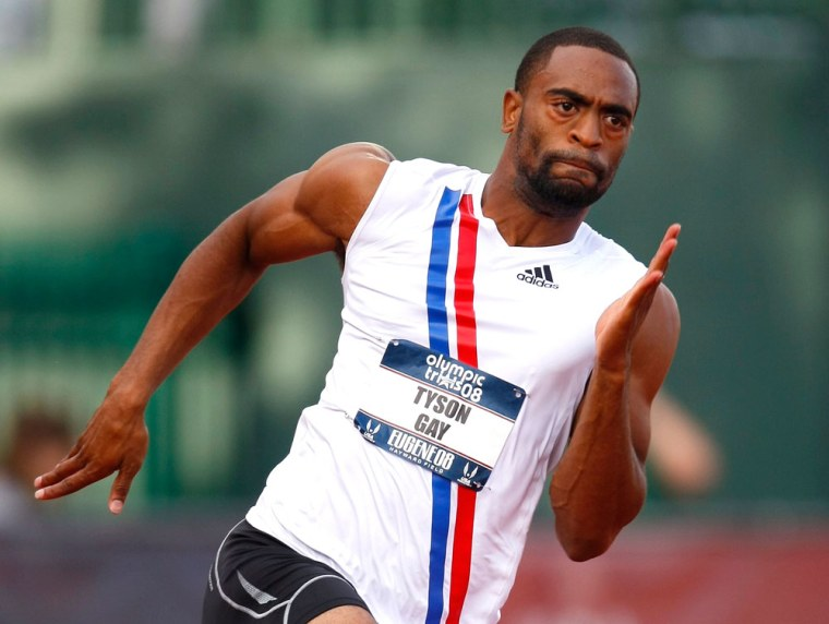 Image: Tyson Gay runs through a corner during his first round men's 200m heat at the U.S. Olympic Track and Field Trials