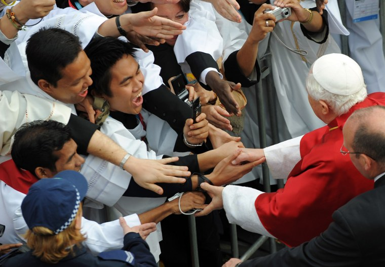 Pope Benedict XVI meets pilgrims as he arrives in Randwick Racecourse in Sydney, Australia, on Sunday for a Mass. He met on Monday with victims of sexual abuse by priests.