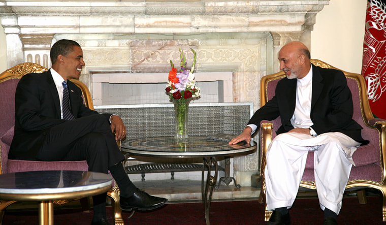 Afghan President Hamid Karzai, right,talks with Democratic presidential contender Barack Obama during a meeting Sundayat the Presidential Palace in Kabul.