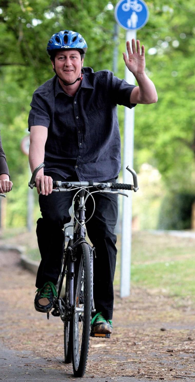 David Cameron rides his bike