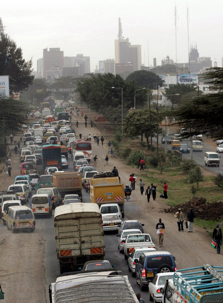 Image: Downtown Nairobi, background, is seen as traffic is backed up on a busy road