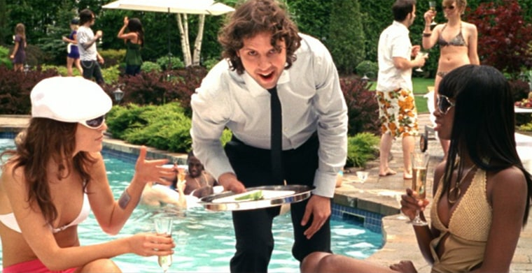 Poor Baby-faced Everyman — forced to cater waiter a big L.A. rock star party (in a yet-to-be released commercial) that should be his — if only he'd do something about his lousy credit score!