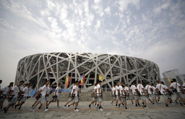 Image: Performers arrive for a rehearsal of the opening ceremony at the National Stadium ahead of the Beijing 2008 Olympic Games