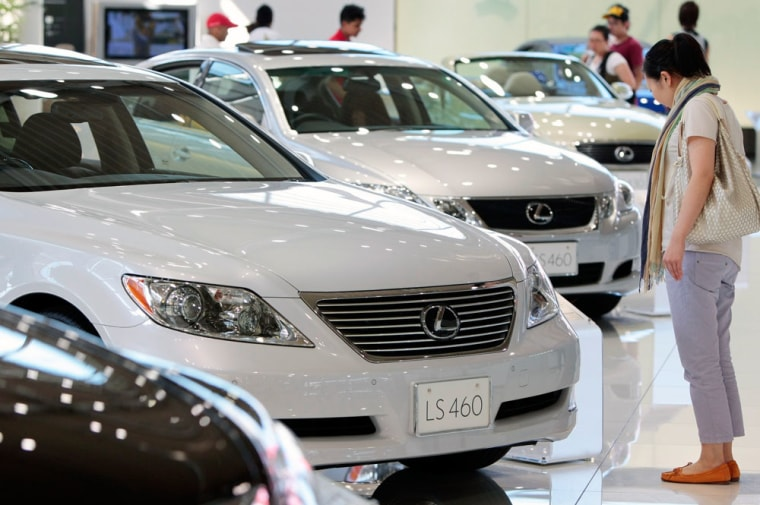 Image: A customer looks at a Lexus