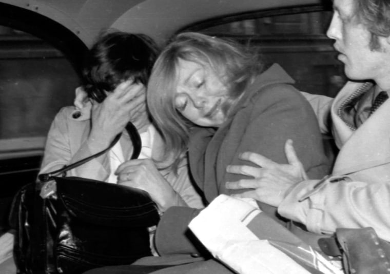 This photo from February 1978 shows Joyce McKinney, center, a former beauty queen from North Carolina, in the back of a London taxi with her mother and an unidentified man after being granted permission by a judge to vary the terms of bail in connection with her coming kidnap trial. She jumped bail and was never brought to justice.