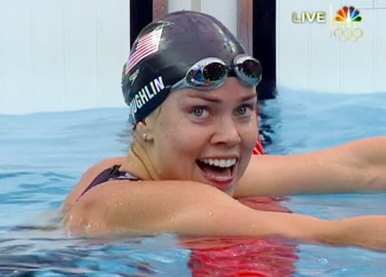 Natalie Coughlin of the United States wins gold in the 100 backstroke, becoming the first woman to ever defend her title in the event.