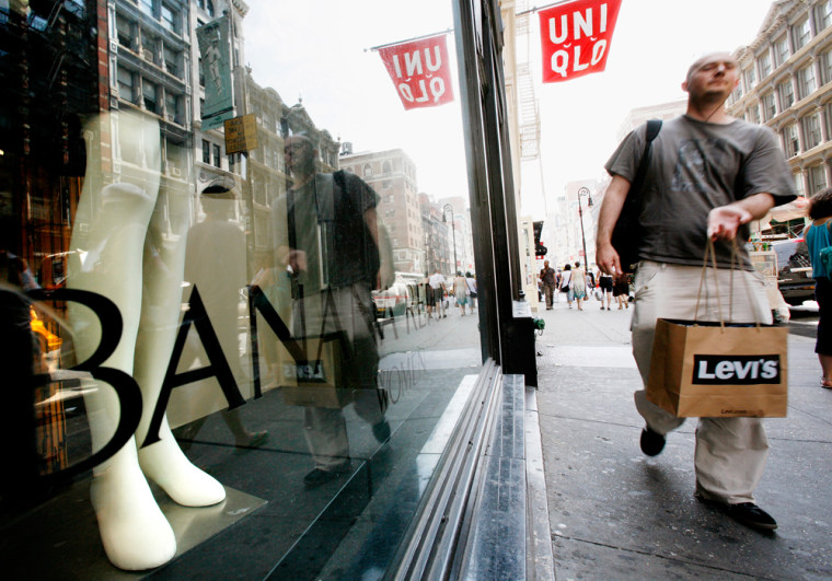 Image: Shoppers walk along Broadway in New York's Soho shopping district