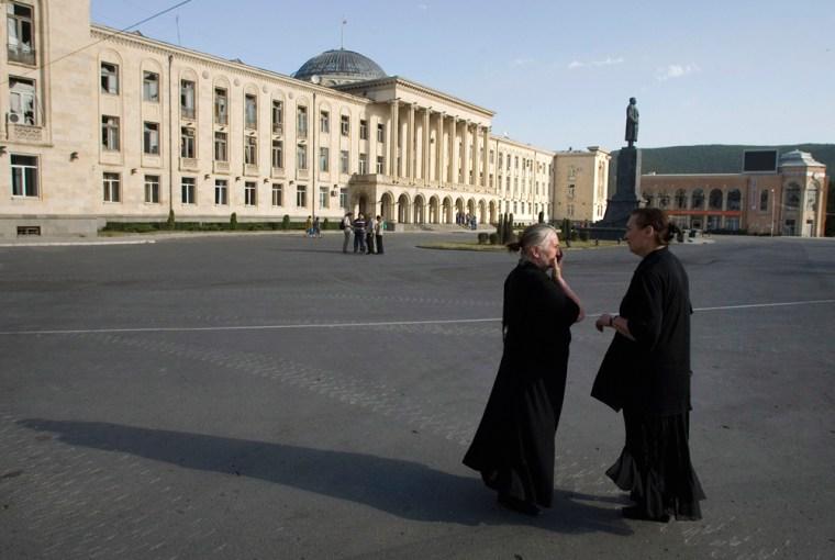 Image: Two women talk in a square in Gori