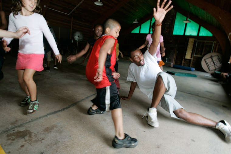 Image: Kids  dance with their instructor at the Homeward Bound Camp