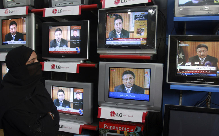 Image: A Pakistani woman watches President Pervez Musharraf resignation speech on TV