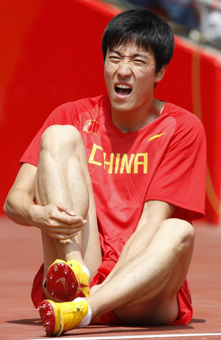 Image: China's Xiang Liu retires from the first round of the men's 110m hurdles