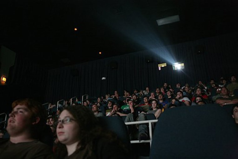 """Fans watching the first showing of """"Indiana Jones and the Kingdom of the Crystal Skull""""in Tyler, Texas. Hollywood studios and neuroscientists are increasingly using technologies such as brain scans to peer inside the minds of moviegoers."""