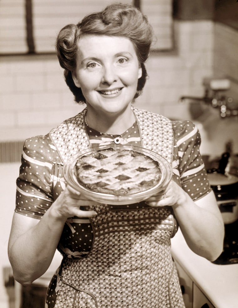 Image: Aproned Housewife Presents Homemade Pie