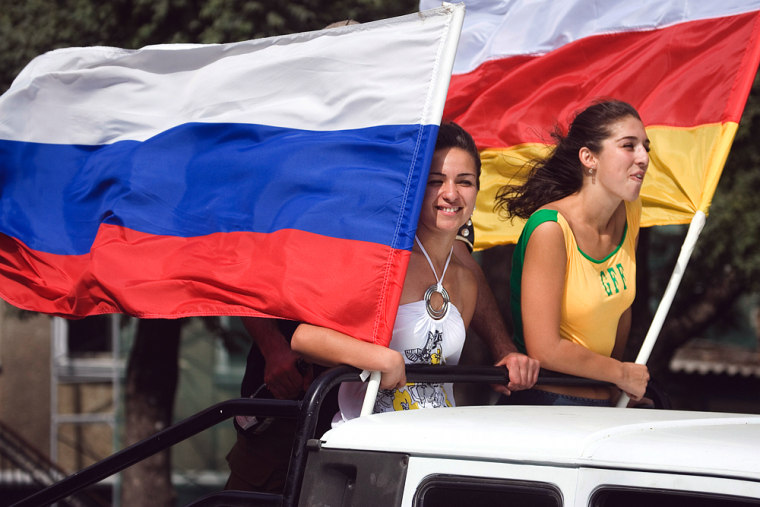 Image: Russian and South Ossetian flags