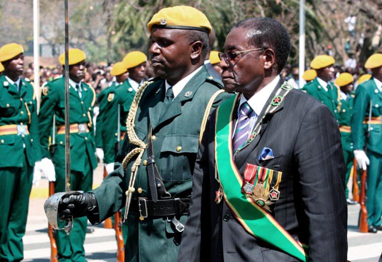 Image: Zimbabwe President Robert Mugabe arrives at Parliament