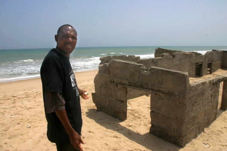 Image: House abandoned five years ago to rising sea and sand, in Totope, Ghana