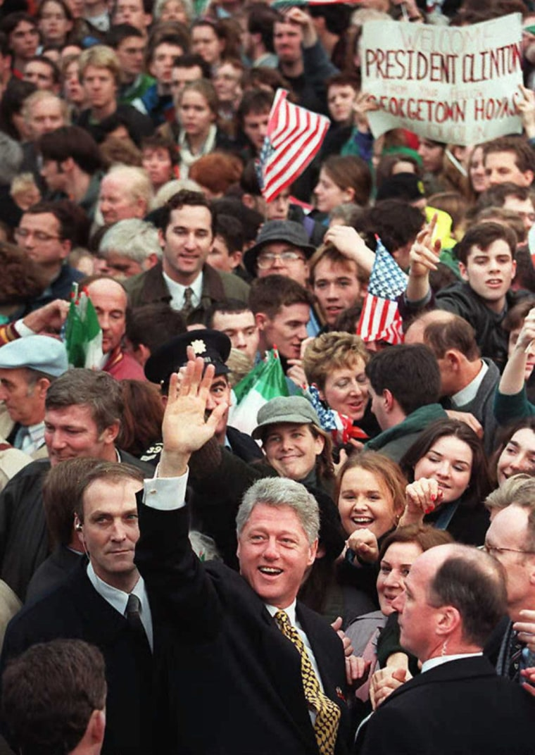 Image: US President Bill Clinton waves