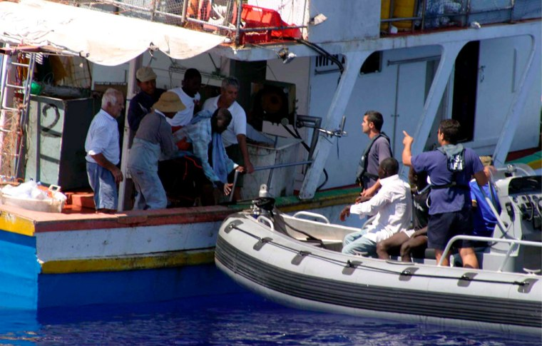 Image: African illegal immigrants being helped by Armed Forces of Malta