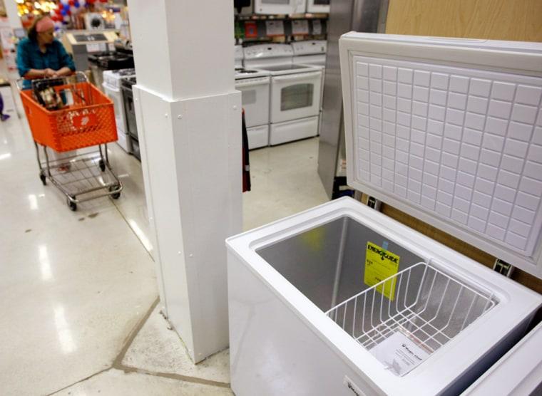 Image: A shopper passes a freezer