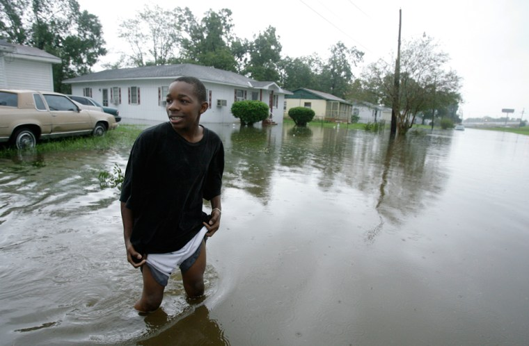 Image: A boy wades in water