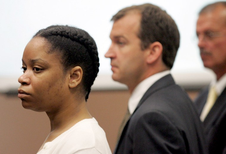 China Arnold, left, in court on Wednesday withher lawyers, Jon Paul Rion, center, and Kevin Lennen. She chose not to be in the courtroom during her sentencing on Monday.