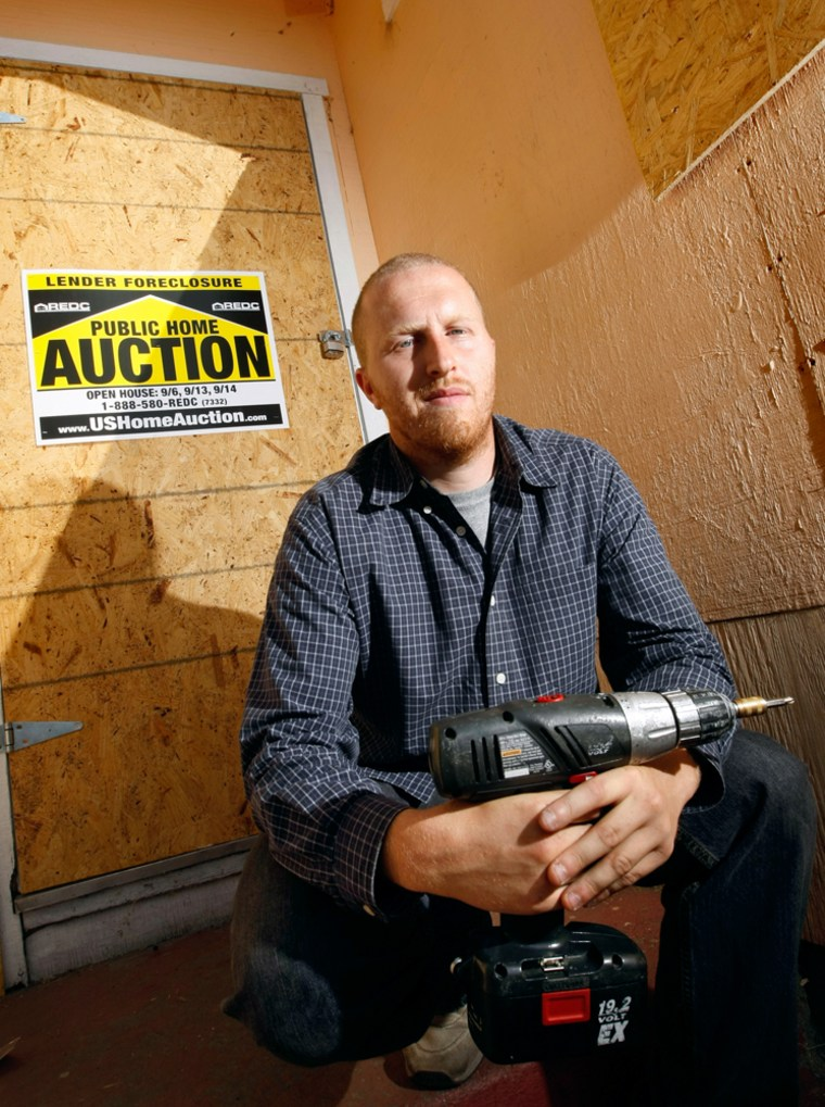 Jason Norton, a contractor and owner of Bay Area Board Up, stands outside a foreclosed home he and his staff boarded up in Oakland, Calif. Norton mainly works for lenders and banks who have repossessed properties through foreclosure proceedings.