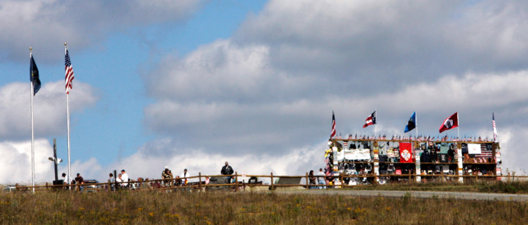 Image: Visitors are seen at the Flight 93 Temporary Memorial outside Shanksville, Pennsylvania