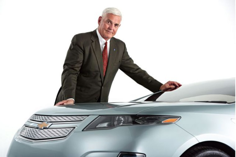 In this image, GM Vice Chairman Bob Lutz poses next to a prototype version of the Volt.