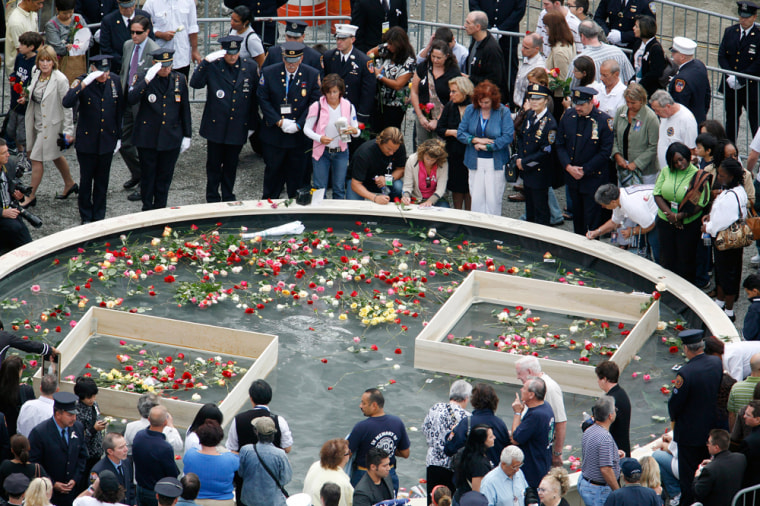 Image: Family members of victims pay their respects