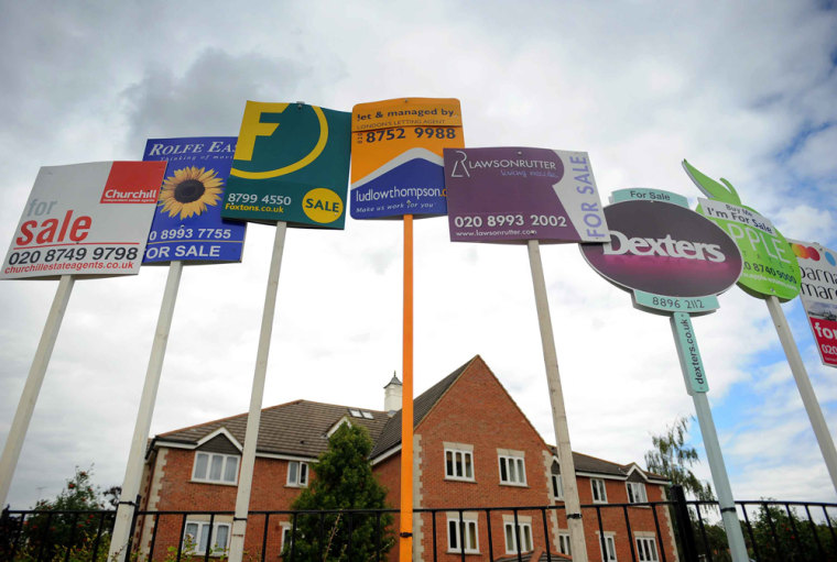 Image: Residential property sales signs seen in London