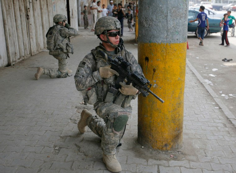 Image: US soldiers secure an area during a military patrol in central Baghdad