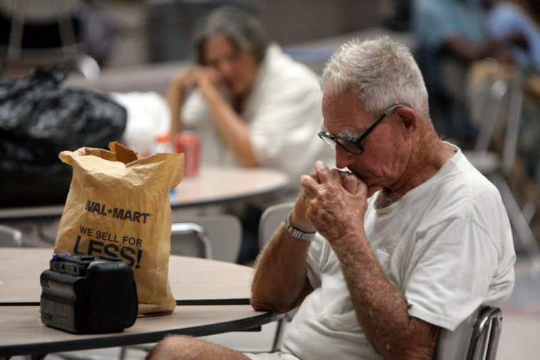Image: People sleeping in the cafeteria at Ball High School used as a shelter of last resort for Hurricane Ike