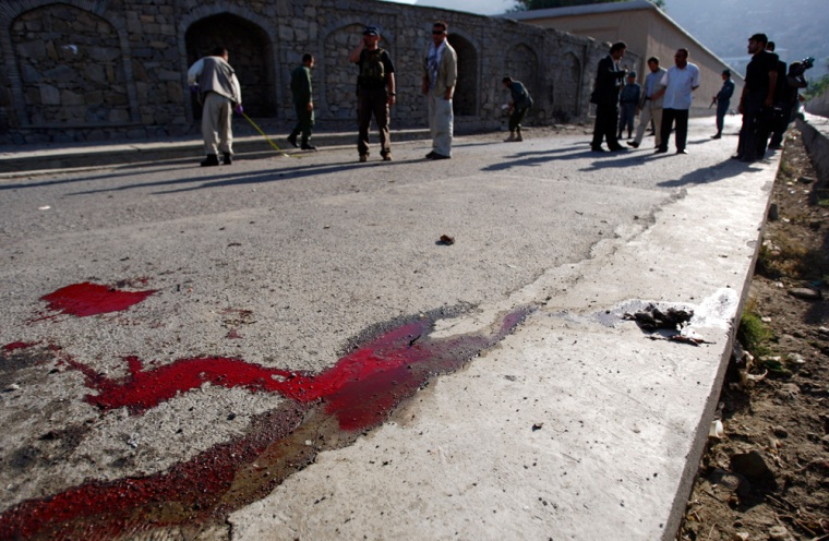 Image: Afghan police secure the area after a suicide bombing in Kabul