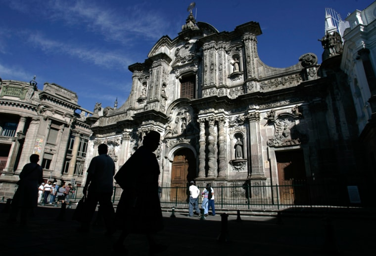 Image: People walk by La Compania de Jesus church in Quito, Ecuador