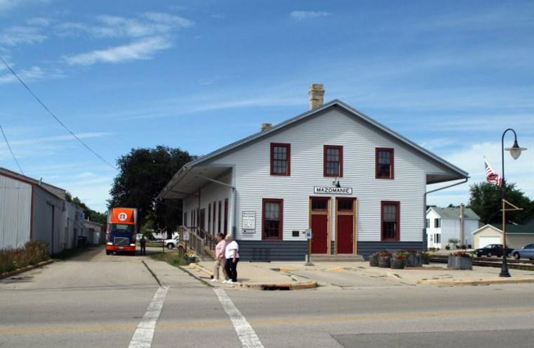Image: Two women walk past the Mazomanie library in Mazomanie, Wisconsin