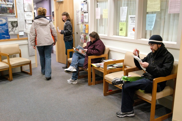 Patients wait for care at a New Hampshire health clinic. How voters will access care — and how they'll pay for it — are vastly different visions under health reform plans proposed by the presidential candidates.