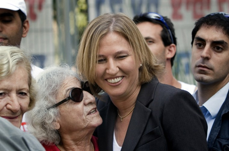 Tzipi Livni, Israeli foreign minister, greets supporters outside the voting station in Tel Aviv during the Kadima elections Wednesday.