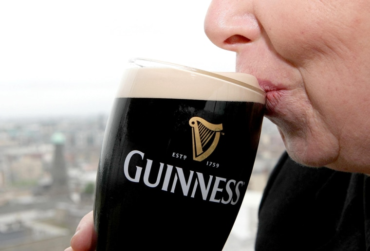 Image: Person drinking Guinness