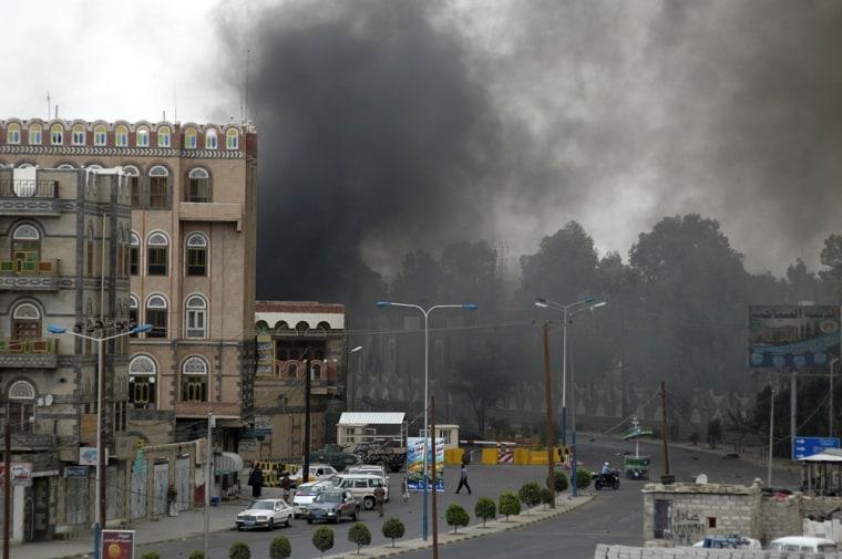 Image: Smoke is seen billowing outside the U.S. embassy in Sanaa, Yemen