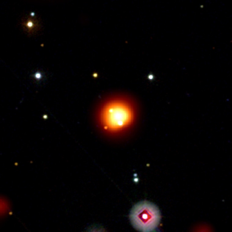 This image merges the view through the Swift satellite's Ultraviolet and Optical Telescope, which shows bright stars, and its X-Ray Telescope, which captured the orange-yellow burst of gamma rays.