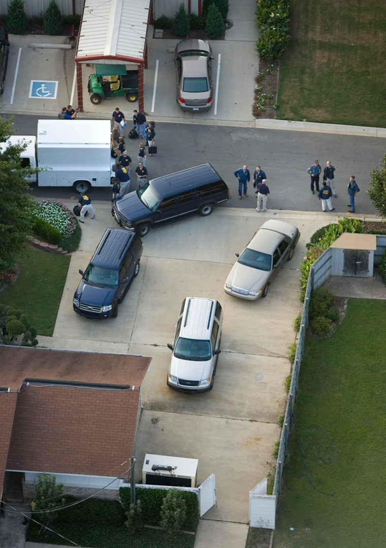 FBI agents execute a search warrant at a residenceinside of the Tony Alamo Ministries compound Saturday evening in Fouke, Ark.
