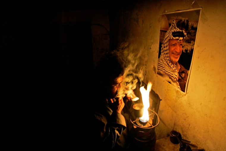 APalestinian vendor smokes a cigarette as he prepares coffee for customers after breaking his fast during the holy month of Ramadan in the West Bank city of Ramallah.