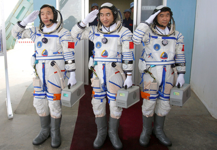 Image: Chinese astronauts before a launch drill at the Jiuquan Satellite Launch Center