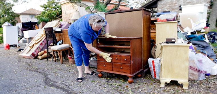 Image: Galveston resident going through damaged furniture