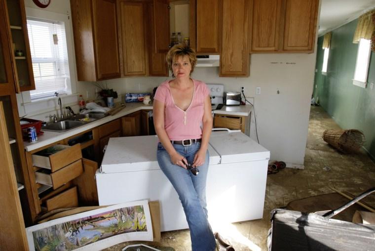 Image:Donnell Landtroop poses for a picture inside her state-supplied Mississippi cottage